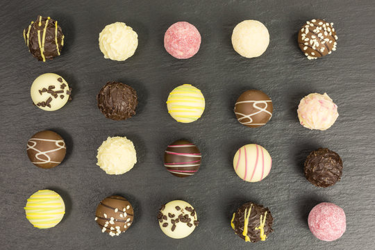 background of different chocolate truffles