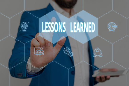 Text sign showing Lessons Learned. Business photo showcasing the knowledge or understanding gained by experience Male human wear formal work suit presenting presentation using smart device