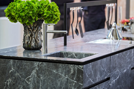 Beautiful modern kitchen design, kitchen faucet and kitchen decor, gray marble kitchen island
