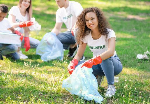 Female volunteer gathering garbage in park