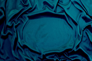 Türaufkleber Stoff Photograph of silk fabric, color blue. The texture of silk fabric. Luxury silk fabric background with waves and drapery. Background for fashion luxury design, close-up, copy space