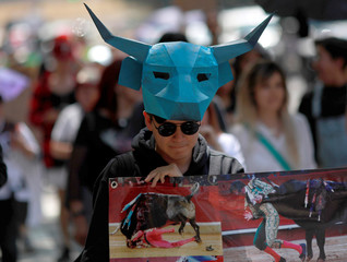 An animal rights activist takes part in a march during a demonstration against bullfighting events and animals in circuses, along Reforma Avenue in Mexico City