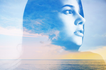 Double multiply exposure abstract portrait of a dreamy cute young woman head silhouette in clouds and sky, sunrise or sunset nature. Psychology power of mind, human spirit, mental health, zen concept. Wall mural