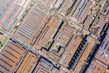 aerial top image of weathered rusty roofs of industrial warehouses and distribution buildings