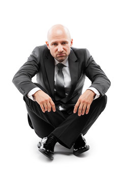 Tired or stressed businessman in depression sitting down floor white isolated