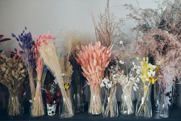 Colorful dried flowers on shelf