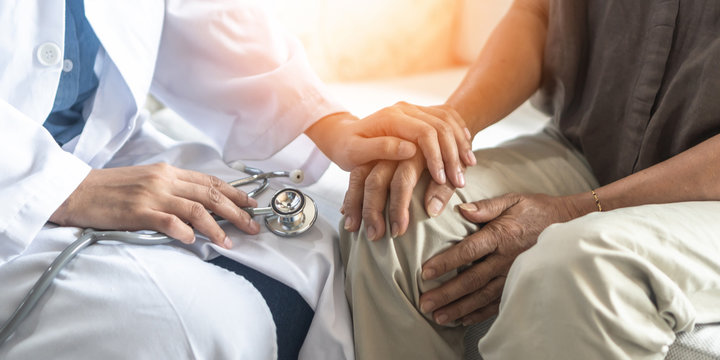 Parkinson's disease patient, Arthritis hand and knee pain or mental health care with geriatric doctor consulting examining comforting elderly senior aged adult in medical exam clinic or hospital