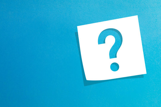 Note paper with question mark on blue background