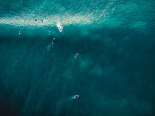 Aerial view with surfers and barrel wave in tropical blue ocean. Top view Wall mural