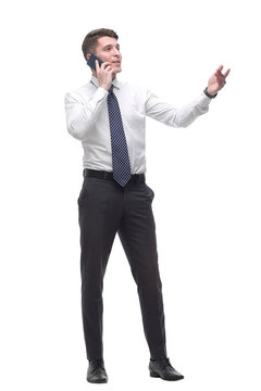 successful young businessman talking on mobile phone. isolated on white