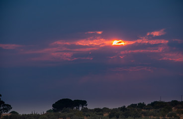 Fotobehang Aubergine Wonderful Sunset in the Clouds, Sicily, Italy, Europe