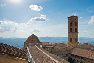 Viewpoint on a surrounding landscape from a bell tower over the roof and dome of Volterra cathedral, Tuscany, Italy