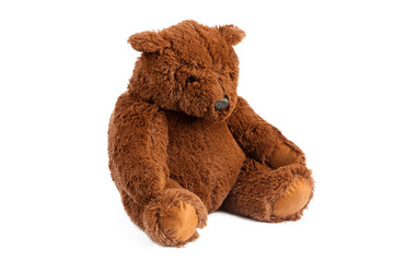 Image of brown toy ugly eddy bear sitting at white isolated background.