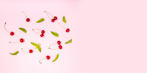 Cherry on a pink background, concept of fruit and healthy eating.