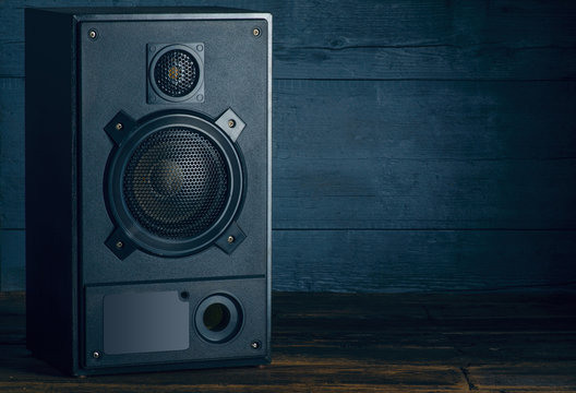 Audio Speakers music stereo on wooden background