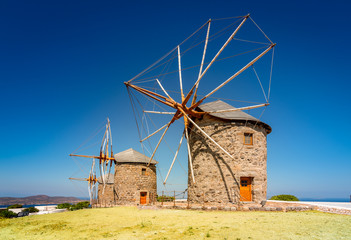 Wall Mural - Old Greek windmills landscape. Patmos Island, Greece.