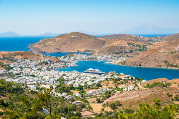 Fotomurales - Landscape view of Skala harbor and town, Patmos Island, Greece.