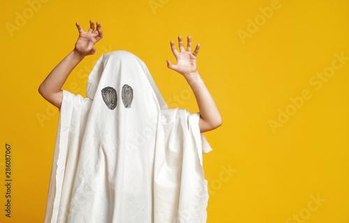 kid in ghost costume