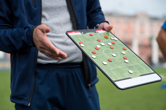 Football tactic education. Coach explains the strategy of the game