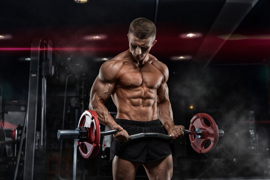 oung adult bodybuilder doing weight lifting in gym.