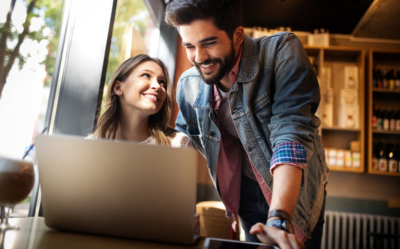 Young couple or college student using laptop computer notebook work together