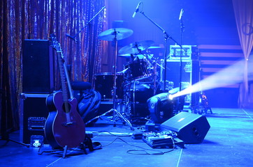 Guitar and other musical equipment on stage before concert - fototapety na wymiar