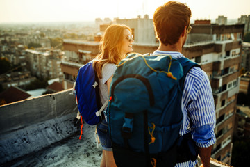 Multiethnic traveler couple using map together on sunny day Wall mural