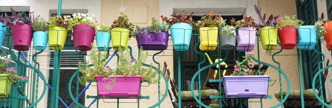 Colorful flowers and flowerpots variety beautiful terrace balcony house exterior