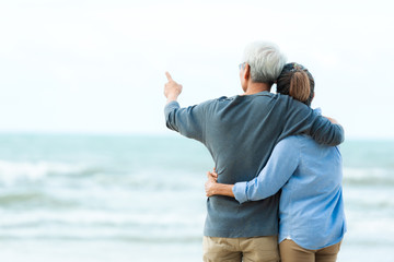 Asian Lifestyle senior couple hug on the beach happy in love romantic and relax time.  Tourism elderly family travel leisure and activity after retirement in vacations and summer. Fototapete