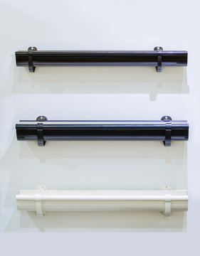 Closeup of rain gutter and drain pipes. Different color options. Drainpipes examples on white background