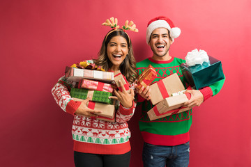 Young Woman And Man With Gift Boxes