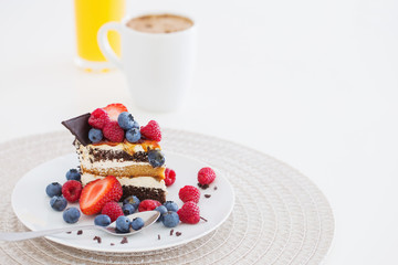 healthy dessert with different berries on white background
