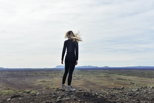 Iceland Crater landscape. Young woman traveller on the top of the crater