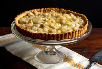 Pear and ginger tart on cake stand