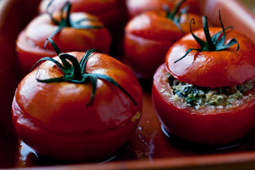 Close up of Sicilian stuffed tomatoes in baking tray