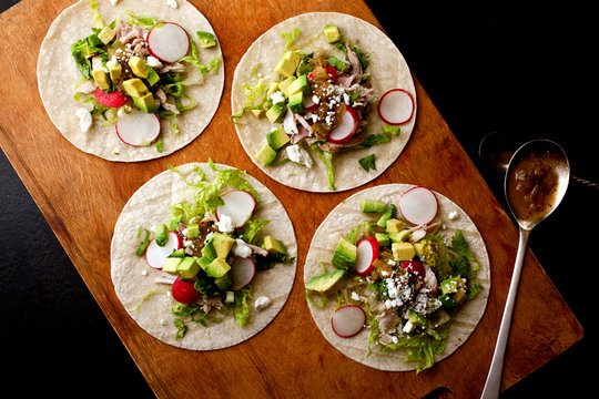 Overhead view of turkey tacos on cutting board