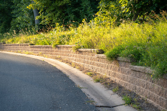 Brick retaining wall on a curve of a paved road