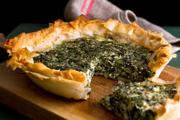 Close up of goat cheese, chard and herb pie in a phyllo crust