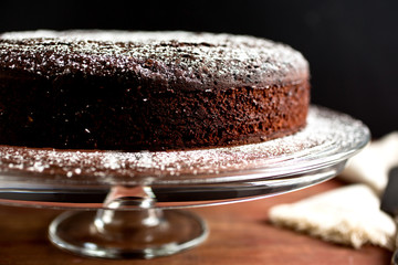 Close up of chocolate whiskey cake on cake stand