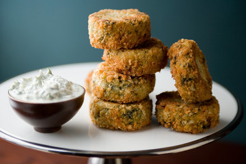 Potato, salmon and spinach patties served with garlic dill cream