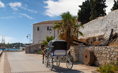 Horse drawn carts, used as taxis on the Greek island of Spetses, Greece