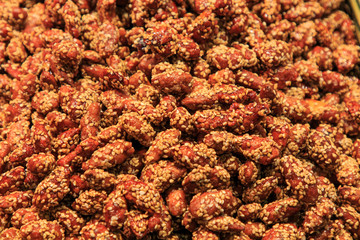 Heap of almonds with sesame seeds at the Boqueria Market. Food concept