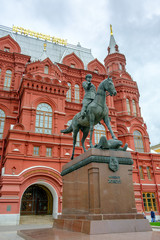 Georgy Zhukov monument against the background of Historical Museum of Russia.