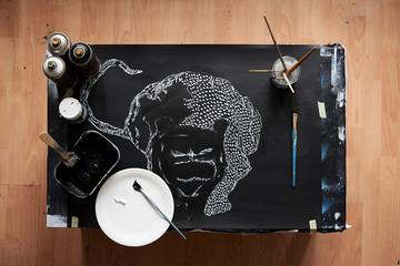 Overhead of artist studio with painting in progress