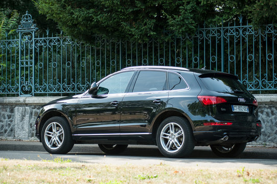 Mulhouse - France - 2 July 2018 - black Audi Q5 crossover parked in the street in front of park