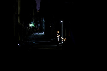 Palestinians use their mobile phone torches during power cut at Al-Shati refugee camp in Gaza City