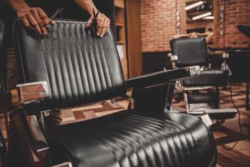 Barbershop armchair. Modern hairdresser and hair salon, barber shop for men
