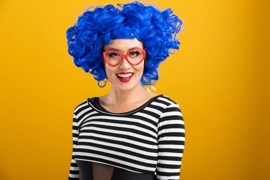 Fun and colorful portrait of woman with blue wig