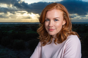 Portrait of pretty woman with red hair
