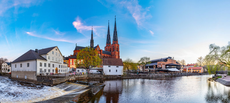 Sunset view of white building of Uppland museum and cathedral in Uppsala, Sweden